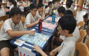 Children playing Chinese Chess
